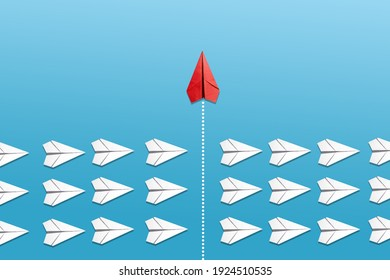 Group of white paper planes fly in a circle and one red paper plane pointing in different way on blue background. Business for new ideas creativity, innovative and solution concept.