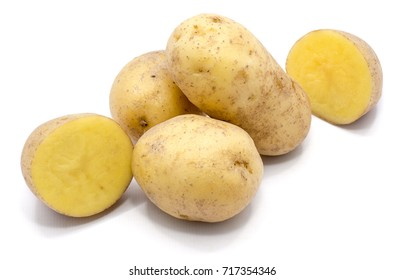 Group of whole potatoes and two halves isolated on white background