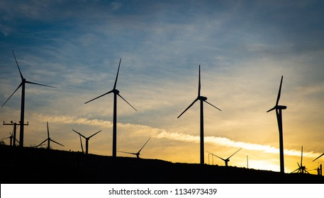 A group of wind turbines at Dawn