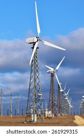 Group of windmill for renewable electric energy production, landscape, cloud, sky