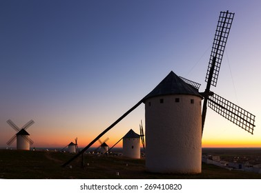 Group of  windmills at field in dusk.  Spain