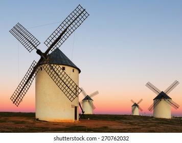 Group of  windmills at field in sunrise.   La Mancha, Spain