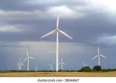 Group of windmills with stormy sky