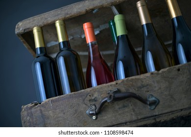 Group of Wine bottle on a Old wood case on a black Background