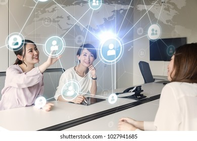 Group of woman using holographic interface.