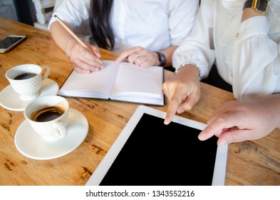 group of woman working in cafe