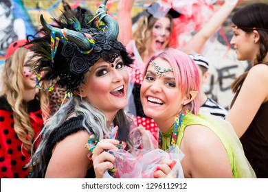 Group of women celebrating German Fasching Carnival in sexy costumes