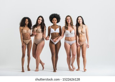 Group of women with different body and ethnicity posing together to show the woman power and strength. Curvy and skinny kind of female body concept