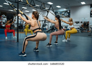 Group of women doing exercise in gym, back view