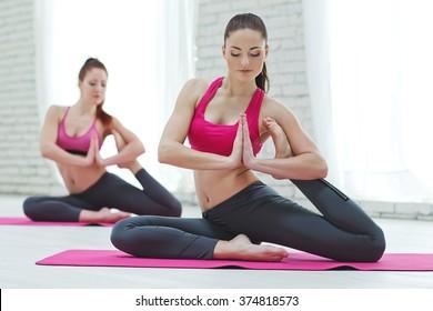 Group Of Women Doing Yoga Indoors