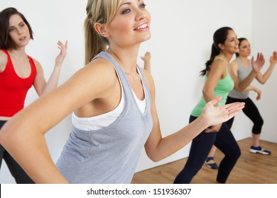 Group Of Women Exercising In Dance Studio