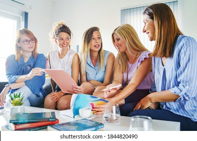 Group of women female only colleagues or friends working together on project sitting on sofa bed in room or at work - Millennial entrepreneurs having meeting brainstorming female empowerment concept
