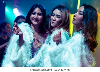 Group of women friend having fun at party in dancing club at night . Social gathering event and nightlife entertainment concept .
