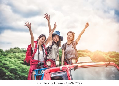 Group of Women Friends Backpacker Enjoy Road Trip Traveling and Camping in the Forest in Weekend Summer - Travel and Recreation Concept