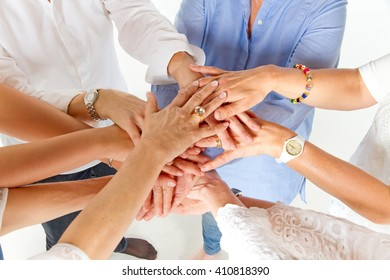 Group of women with hands together showing unity