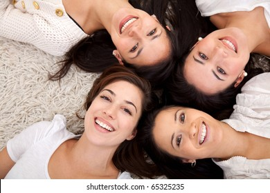 Group of women lying on the floor and smiling