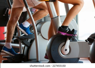 group of women and men - doing sport Spinning in the gym for fitness