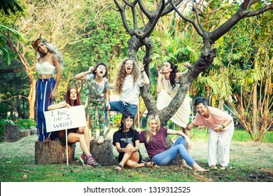 "Group of women in nature with a poster  ""I live like I want!""  International Womens Day concept."