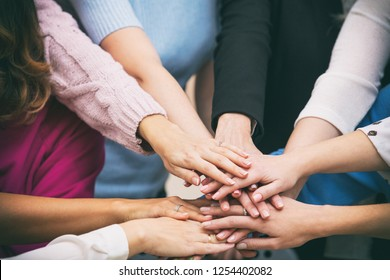 Group of women in the office at the seminar together discuss topics of interest hands close up