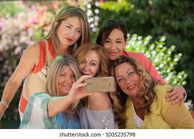 group of women party selfie with smart phone