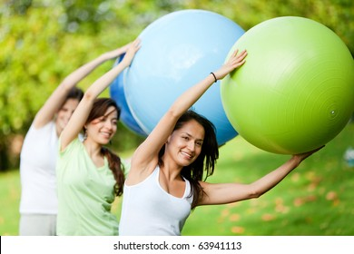 Group of women in a pilates class outdoors