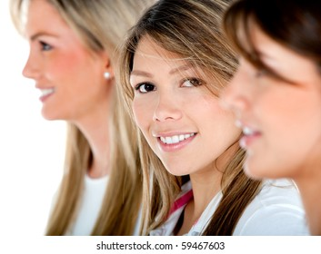 Group of women in a row smiling - isolated over a white background