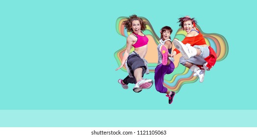 group of  women in sport dress jumping at fitness, dance or aerobics excercise