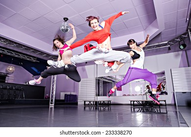 group of  women in sport dress jumping at fitness dance exercise or aerobics