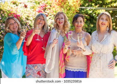group of women toasting with glass of sparkling wine