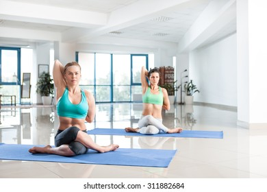 Group of women training yoga in the gym