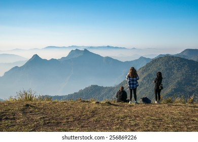 Group of women traveller standing to see the highland mountains in northern region of Thailand.