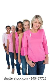 Group of women wearing pink tops and ribbons for breast cancer on white background