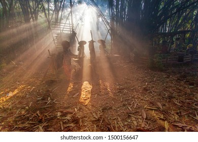 Group of women winnowing the paddy at traditional market s with ray of light in Bogor West Java Indonesia. 07 07 2019