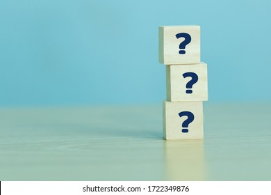 Group of wooden  block with sign question mark symbol on the table over sky blue background, element of banner design concept