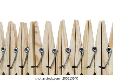 Group of wooden clothespins isolated over white