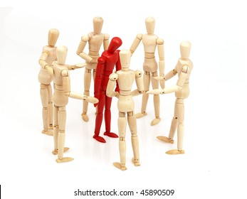 Group of wooden mannequins.