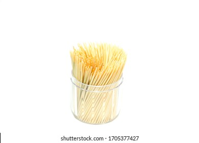 a group of wooden toothpicks in plastic box isolated on white background.