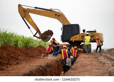 Group of worker and construction engineer wear safety uniform excavation water drainage at construction site