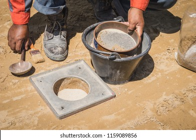 A group of workers are doing a field density test at the construction site .Soil field density test sand cone method calculation in construction site. field density test sand cone method calculation.