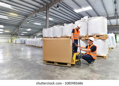 group of workers in the logistics industry -  scanning barcode