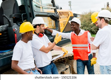 Group of workers talking at a building site