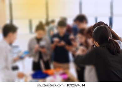 Group workshop of smartphone with business team in classroom. Personal development, personal and career growth, progress and potential concepts. Blurry Background