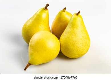 Group of yellow pears on a white background