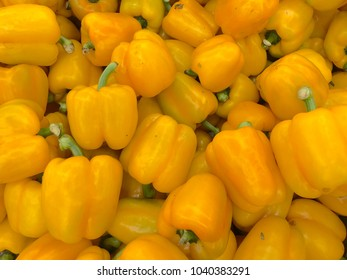 A group of yellow sweet bell peppers sell in market
