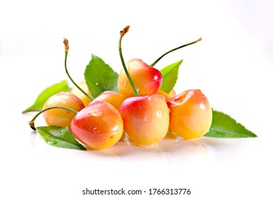 Group of yellow sweet cherries on white background