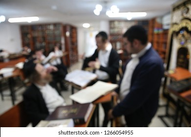 A group of Yeshiva (Hebrew for school) students learn Torah together as in Jewish tradition