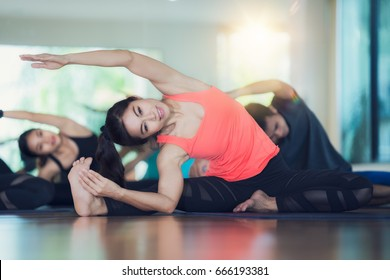 Group of Yoga exercise and class in fitness center, man and lay relax in gym