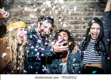Group of young adults hanging around in a disco club