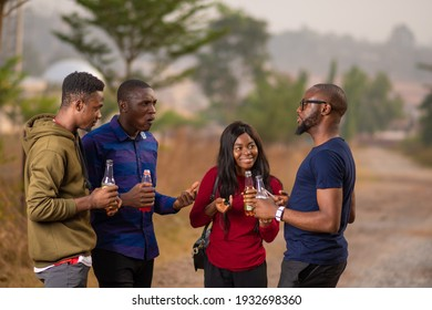 group of young african friends having a get together party, having drinks and discussion