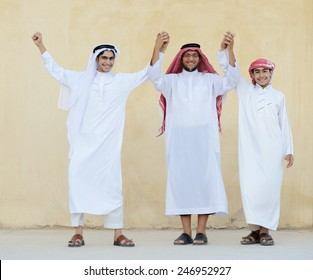 Group of young Arabic Gulf people dancing and celebrating eid party